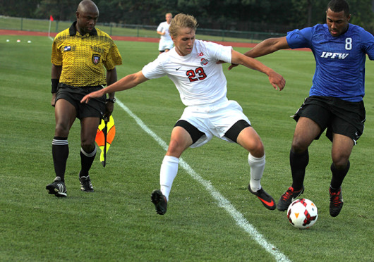 Junior midfielder Ryan Ivancic races his opponent to the ball during a game against IPFW Aug. 20, at Jesse Owens Memorial Stadium. OSU won, 2-0.
