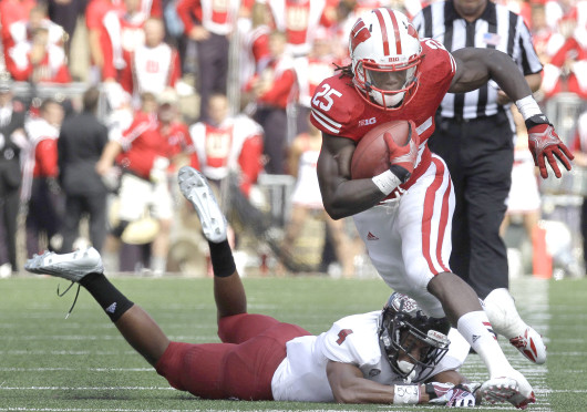Wisconsin running back Melvin Gordon (25) avoids the tackle of Massachusetts defensive back Randall Jette in the second quarter on Saturday, August 31, 2013, at Camp Randall Stadium in Madison, Wisconsin. The Badgers defeated UMass, 45-0. Credit: Courtesy of MCT