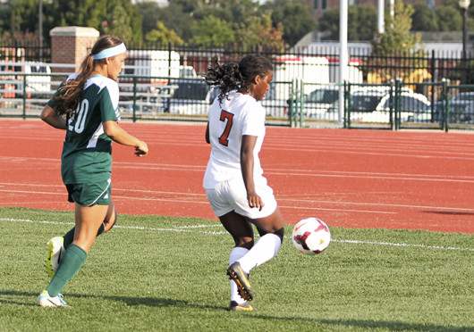 Freshman forward Nichelle Prince (7) chases down the ball in a game against Eastern Michigan Aug. 25. OSU won, 2-1, in OT. Photo credit: Shelby Lum / Photo editor