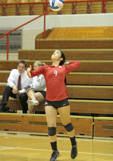 Shelby Lum / Photo editor Freshman defensive specialist Valeria León serves the ball before a match against Dabrowa, Sept. 4 at St. John Arena. OSU won, 3-2.