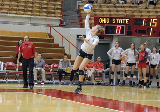 Junior setter Taylor Sherwin serves the ball during a match against Dabrowa Sept. 4, at St. John Arena. OSU won, 3-2.