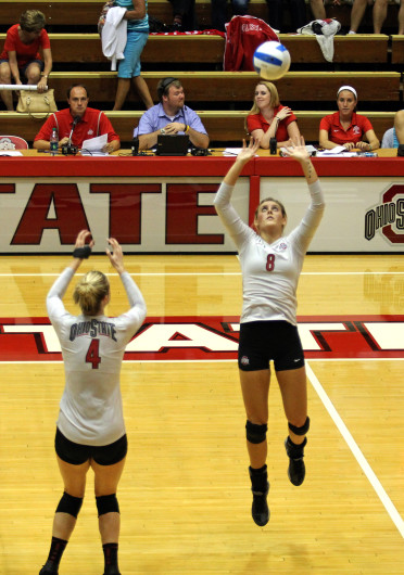Junior setter Taylor Sherwin sets the ball up for a teammate during a game against Dabrowa Sept. 4, at St. John Arena. OSU won, 3-2. Credit: Shelby Lum / Photo editor