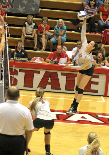 Junior outside hitter Erin Sekinger (12) spikes the ball during a match against Dabrowa Sept. 4, at St. John Arena. OSU won, 3-2. Credit: Shelby Lum / Photo editor