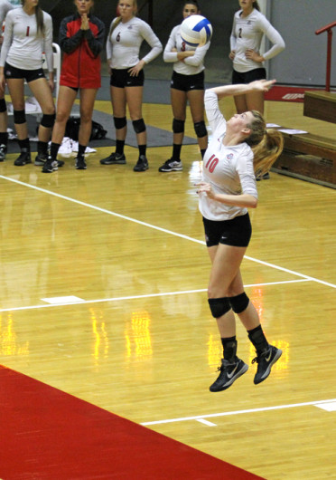 Freshman right side hitter Taylor Sandbothe (10) serves the ball during a game against Dabrowa Sept. 4 at St. John Arena. OSU won, 3-2. Credit: Shelby Lum / Photo editor