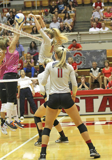 Freshman right side hitter Taylor Sandbothe (10) blocks the ball during a match against Dabrowa Sept. 4 at St. John Arena. OSU won, 3-2. Credit: Shelby Lum / Photo editor