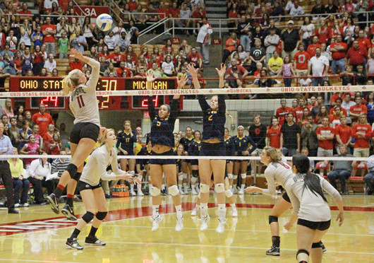 Senior outside hitter Kaitlyn Leary (11) spikes the ball during a match against Michigan Sept. 27 at St. John Arena. OSU won, 3-1. Credit: Mark Batke / Lantern photographer