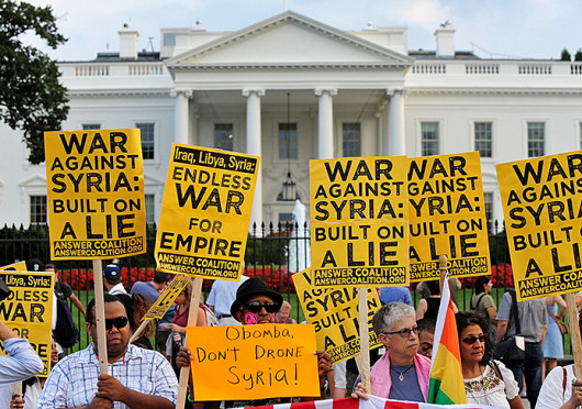 Demonstrators rally on the north side of the White House in Washington, D.C., to protest any US military action against Syria Aug. 29.