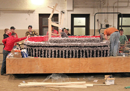 FarmHouse International Fraternity members work on their float for this year's homecoming parade.  Credit: Courtesy of Brent Stammen
