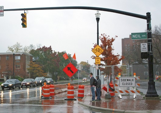 OSU students wait to cross the street at the corner of Lane and Neil avenues beside closed portions of Lane Avenue Oct. 31. Credit: Sam Harrington / Lantern photographer