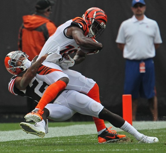 Cincinnati Bengals wide receiver A.J. Green, right, is stopped after catching a pass for a short gain by Cleveland Browns defensive back Joe Haden at FirstEnergy Stadium Sunday, Sept. 29. The Browns won, 17-6. Credit: Courtesy of MCT