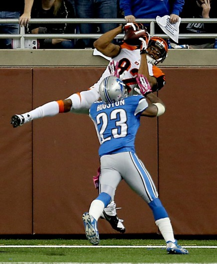 Cincinnati Bengals' Marvin Jones catches a touchdown pass against Detroit Lions' Chris Houston during second-quarter action at Ford Field Sunday, Oct. 20. Credit: Courtesy of MCT
