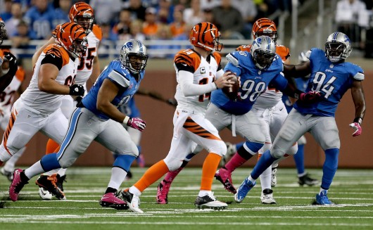 Detroit Lions' Ndamukong Suh, Nick Fairley and Ezekiel Ansah pursue Cincinnati Bengals' Andy Dalton during a game at Ford Field Oct. 20. The Bengals won, 27-24. Credit: Courtesy of MCT