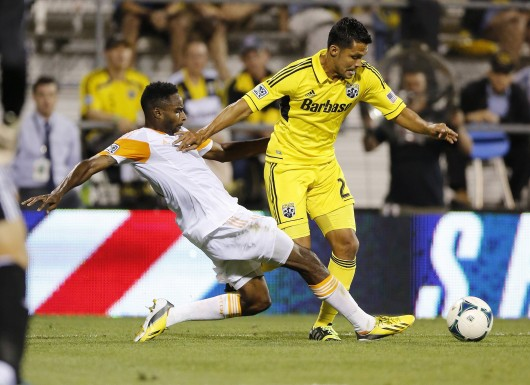 Columbus Crew forward Jairo Arrieta (25) battles for a ball with Houston Dynamo defender Warren Creavalle (5) during a game at Columbus Crew Stadium Sept. 4. The Crew won, 2-0. Credit: Courtesy of MCT