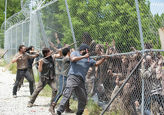 Glenn (Steven Yeun), Rick Grimes (Andrew Lincoln), Daryl Dixon (Norman Reedus) and Sasha (Sonequa Martin -Green) in a scene from 'The Walking Dead,' which airs Sundays on AMC.  Credit: Courtesy of Gene Page / AMC