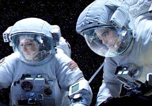 Sandra Bullock (left) and George Clooney in a scene from 'Gravity,' which is set to hit theaters Oct. 4.  Credit: Courtesy of Gofobo