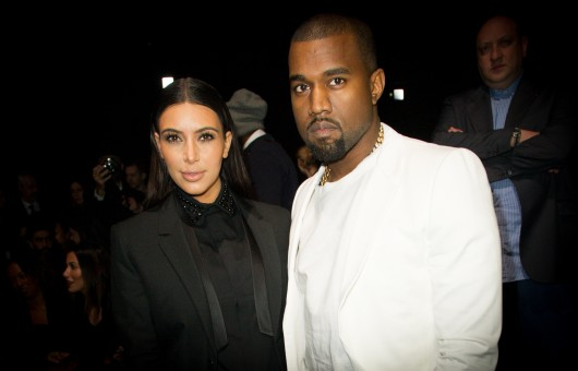 Kim Kardashian (left) and Kanye West at the Givenchy Fall-Winter 2013/2014 Ready-To-Wear collection show on March 3. The two became engaged Oct. 21.  Credit: Courtesy of MCT