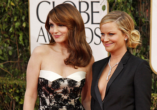 Tina Fey, left, and Amy Poehler at the 70th Annual Golden Globe Awards Jan. 13. The pair is set to host the next two Golden Globes.  Credit: Courtesy of MCT