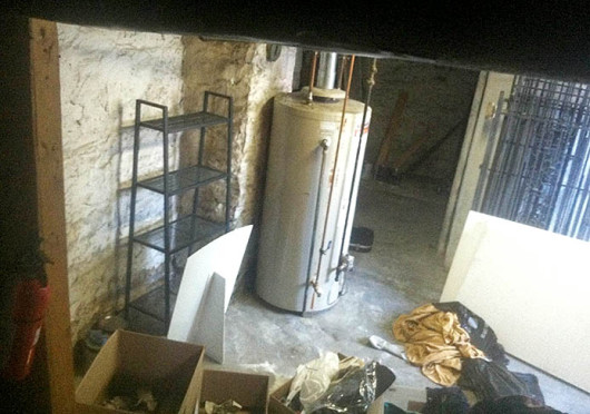 The water heater in question has provided little information as to how long it's been secretly living in the basement. As of yet, no charges have been filed. Credit: Cory Frame / Lantern reporter