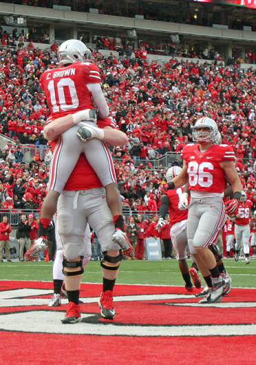 Wide receiver Corey 'Philly' Brown (10) celebrates a touchdown during a game against Iowa Oct. 19 at Ohio Stadium. OSU won, 34-24. Credit: Shelby Lum / Photo editor