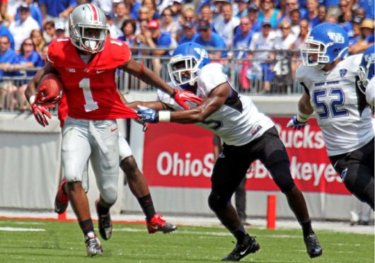 Freshman running back Dontre Wilson fights off a defender during a game against Buffalo Aug. 31 at Ohio Stadium. OSU won, 40-30. Credit: Shelby Lum / Photo editor