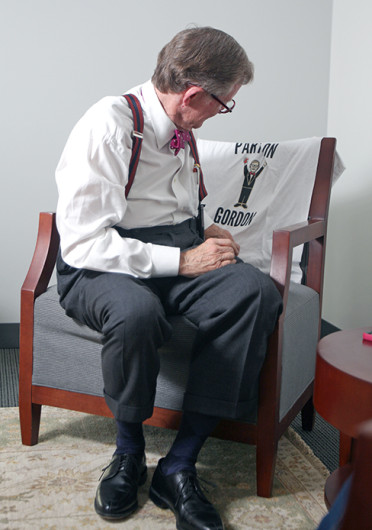OSU President Emeritus E. Gordon Gee looks at a shirt during an interview with The Lantern Oct. 21. Credit: Shelby Lum / Photo editor