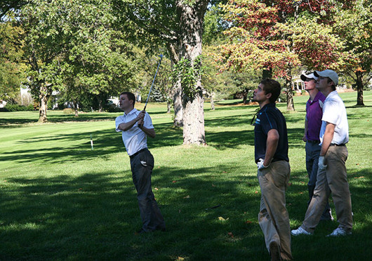 Paul Mann (left), a fourth-year OSU student in mechanical engineering, watches his shot on the 13th hole at the Worthington Hills Country Club during the inaugural Scott Harman Memorial Golf Outing Oct. 9. Credit: Michael Burwell / Lantern photographer