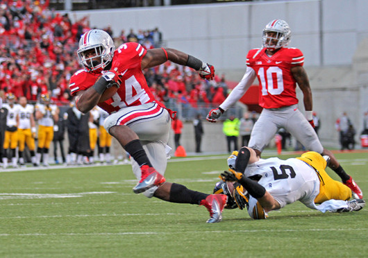 Senior running back Carlos Hyde breaks a tackle on his way to a touchdown during a game against Iowa Oct. 19 at Ohio Stadium. OSU won, 34-24. Credit: Shelby Lum / Photo editor