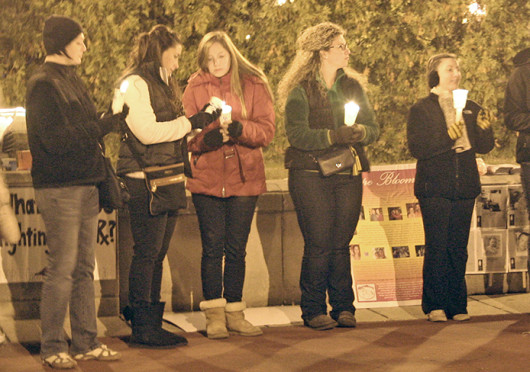 OSU students light candles in memory of people who died from prescription drug overdoses during a vigil Oct. 24 at Browning Amphitheater. Credit: Michele Theodore / Copy chief