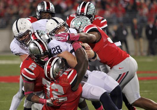 OSU players pile up on Penn State running back, Zach Zwinak (28). OSU won against Penn State, 63-14, at Ohio Stadium Oct. 26. Credit: Ritika Shah / Asst. photo editor