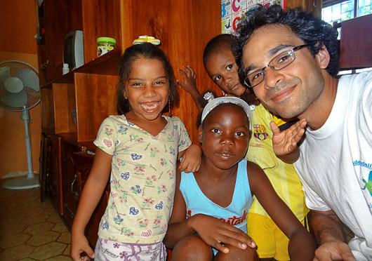 Adam Pervez, a 2004 OSU graduate, poses with children at an orphanage in Atacames, Ecuador. Credit: Courtesy of Adam Pervez