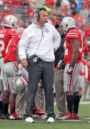 OSU coach Urban Meyer stands during a game against Iowa Oct. 19 at Ohio Stadium. OSU won, 34-24. Credit: Shelby Lum / Photo editor