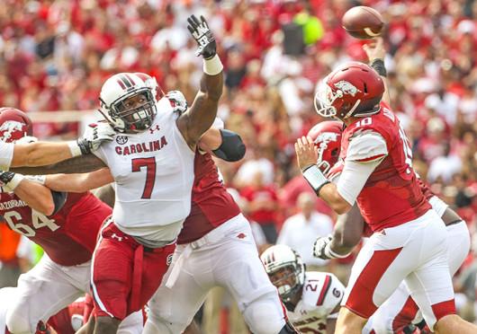 South Carolina defensive end Jadeveon Clowney (7) pressures the quarterback during a game against Arkansas Oct. 12 at Donald W. Reynolds Razorback Stadium. South Carolina won, 52-7. Credit: Courtesy of MCT
