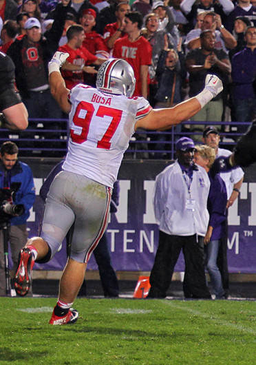 Freshman defensive lineman Joey Bosa (97) celebrates during a game against Northwestern Oct. 5 at Ryan Field. OSU won, 40-30. Credit: Shelby Lum / Photo editor