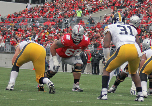 Sophomore right tackle Taylor Decker (68) gets set to block a defender during a game against Iowa Oct. 19 at Ohio Stadium. OSU won, 34-24. Credit: Shelby Lum / Photo editor