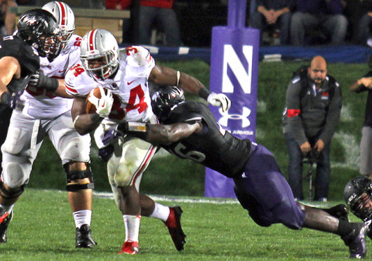 Senior running back Carlos Hyde (34) breaks a tackle during a game against Northwestern Oct. 5 at Ryan Field. OSU won, 40-30. Credit: Shelby Lum / Photo editor