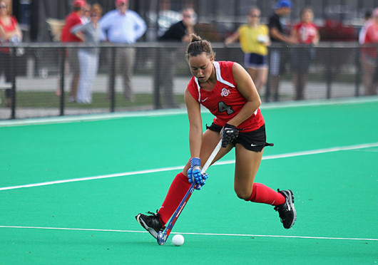 Junior back Carly Mackessy (4) controls the ball during a game against Louisville Oct. 1 at Buckeye Varsity Field. OSU lost, 6-3. Credit: Shelby Lum / Photo editor
