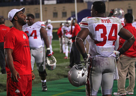 Redshirt-senior running back Jordan Hall and senior running back Carlos Hyde (34) talk on the sidelines after a game against Northwestern Oct. 5 at Ryan Field. OSU won, 40-30. Credit: Kaily Cunningham / Multimedia editor