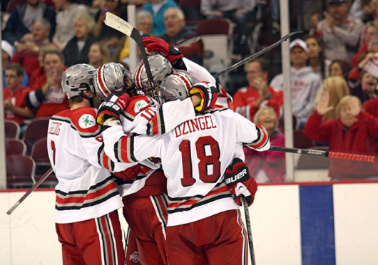 OSU players celebrate after the Buckeye's first goal of the game against Miami (Ohio) Oct. 11 at the Schottenstein Center. OSU lost, 6-2. Credit: Matthew Homan / Lantern photographer