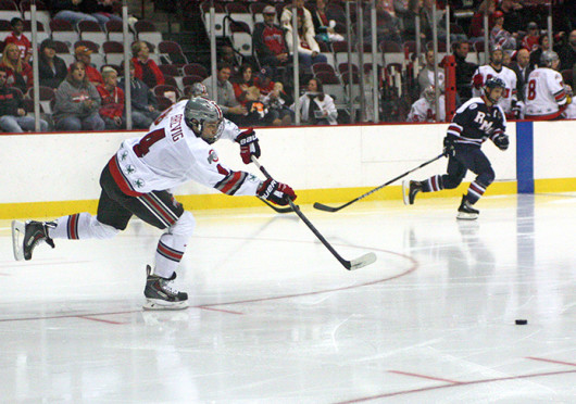 Freshman defenseman Drew Brevig (4) passes the puck during a game against Robert Morris Oct. 25 at the Schottenstein Center. OSU won, 5-3. Credit: Julia Hider / Lantern photographer