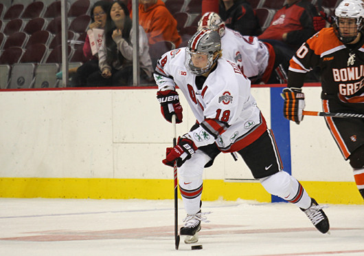 Junior forward Tanner Fritz (16) takes a shot during a game against Bowling Green Oct. 29 at the Schottenstein Center. OSU won, 5-3. Credit: Shelby Lum / Photo editor