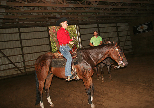 First-year in operations managment Elissa Bening (center) and second-year in science and technology exploration Aaron Boone ride during an equestrian team practice at Autumn Rose Farm in Plain City, Ohio, Oct. 4. Credit: Caroline Keyes / Lantern photographer