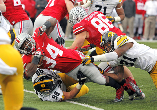 Senior running back Carlos Hyde (34) dives forward during a game against Iowa Oct. 19 at Ohio Stadium. OSU won, 34-24. Credit: Ritika Shah / Asst. photo editor