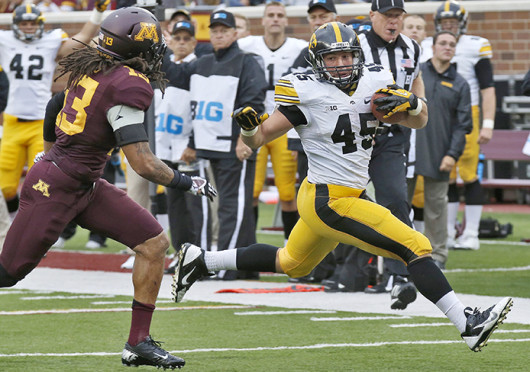 Iowa running back Mark Weisman (45) rushes down the field during a game agianst Minnesota at TCF Bank Stadium Sept. 28. Iowa won, 23-7. Credit: Courtesy of MCT