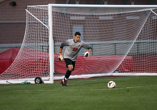 Redshirt-junior goalkeeper Alex Ivanov prepares to take a free kick during a match against Wright State Sept. 17 at Jesse Owens Memorial Stadium. The teams tied, 0-0. Credit: Shelby Lum / Photo editor
