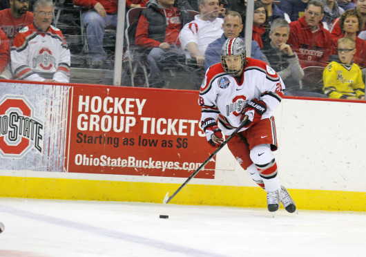 Senior forward Alex Szczechura moves the puck forward in a game against Michigan Feb. 23. OSU lost, 6-3. Credit: Shelby Lum / Photo editor