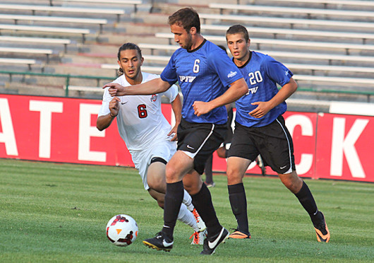 Junior midfielder Yianni Sarris (6) attempts to tackle the opposing player during a match against IPFW Aug. 20 at Jesse Owens Memorial Stadium. OSU won, 2-0. Credit: Shelby Lum / Photo editor