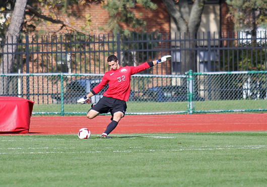 Redshirt-junior goalkeeper Alex Ivanov (32) takes a goal kick during a game against Northwestern Oct. 20 at Jesse Owens Memorial Stadium. The teams tied, 0-0. Credit: Eric Seger / Sports editor