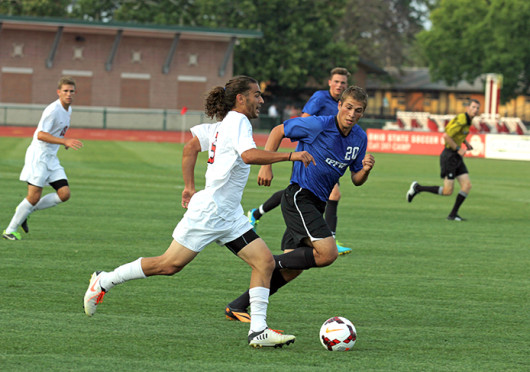 Junior midfielder Yianni Sarris (6) advances the ball in a game against IPFW Aug. 20 at Jesse Owens Memorial Stadium. OSU won, 2-0. Credit: Shelby Lum / Photo editor