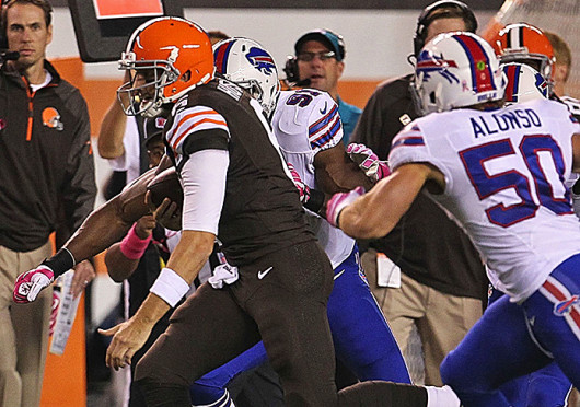 Cleveland Browns quarterback Brian Hoyer (6) is run down by Buffalo Bills linebacker Kiko Alonso as he scrambles toward the sideline during first-quarter action at FirstEnergy Stadium in Cleveland Oct. 3. Credit: Courtesy of MCT