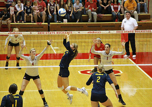 Sophomore middle blocker Andrea Kacsits (4) and freshman outside hitter Kylie Randall (1) set themselves on defense during a match against Michigan Sept. 27 at St. John Arena. OSU won, 3-1.